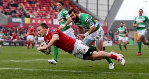 Munster's Andrew Conway runs in for his second try of the game against Treviso. Photograph: Donall Farmer/INPHO