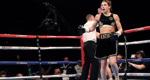 Katie Taylor celebrates her win over Karina Kopinska at the The SSE Arena, Wembley, London. Photograph: Ryan Byrne/Knpho