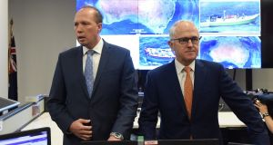 Australia's immigration minister Peter Dutton (left) and prime minister Malcolm Turnbull.  Labor leader Bill Shorten called on Mr Dutton to apologise for comments he made  on immigrants. Photograph: Lukas Coch/EPA