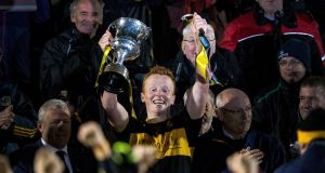Dr Crokes' Johnny Buckley breaks the handle of the cup after lifting it up. Photograph: Cathal Noonan/Inpho