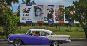 Billboard in Havana depicting  Fidel Castro and reading 'Fidel Among Us',  two days after his death. Photograph: Yamil Lage/AFP/Getty Images