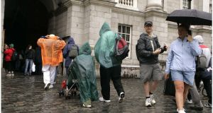 Tourists walk around Dublin city. Ireland's tourism sector enjoyed a record year in 2016, according to Tourism Ireland. File photograph: Dara Mac Dónaill/The Irish Times