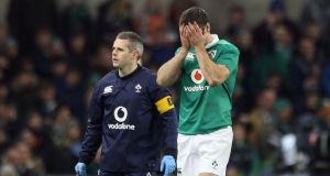 Ireland outhalf Johnny Sexton reacts after sustaining a hamstring injury against New Zealand at the Aviva Stadium. Photograph:  Lorraine O'Sullivan