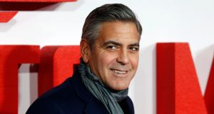 "George Clooney's character in the film Up in the Air describes  his job as being ""hired by cowards who don't have the guts to do their own dirty work"". Photograph: Tal Cohen/EPA"