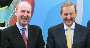 Minister for Transport Shane Ross (left) with  Taoiseach Enda Kenny  at the launch of the Uefa Euro 2020 Host City Logo launch   in  Dublin last week. The Minister has confirmed Mr Kenny waved a copy of the Constitution at him during a Cabinet discussion on neutrality.  File photograph: David Maher/Sportsfile