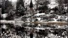 Snow-covered landscape reflected in the lake, at Glendalough, Co Wicklow. Photograph: Eric Luke