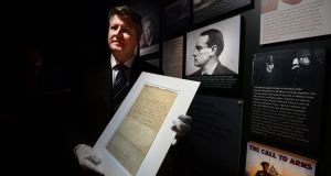 Adam's Fine Art Auctioneers  director Stuart Cole  holding the historic Patrick Pearse surrender letter. Photograph: Cyril Byrne