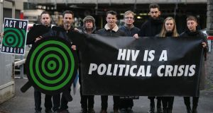 Members of Act UP Dublin LGBT activist group protest outside the Department of Health in Dublin on the eve of World Aids day to highlight the rise of new HIV cases in Ireland.  Photograph:  Niall Carson/PA