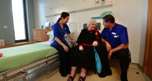 Nora Dodd, patient at  Mercer's Institute for Successful Ageing  at St James's Hospital, Dublin with clinical nurse managers Joan Garcia and Ray Donnelly. Photograph: Dara Mac Dónaill