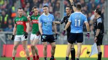 John Small is yellow carded by referee Maurice Deegan during  All-Ireland Senior Football Championship final replay. Photograph: ©INPHO/Ryan Byrne