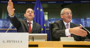 IItalian Socialist MEP Gianni Pittella and European Commission presidentJean-Claude Juncker. Photograph: Julien Warnand/EPA