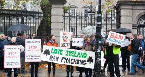 "Anti-fracking protesters outside the Dáil. Minister for the Environment Denis Naughten said that   decisions on fracking ""should be made on the basis of peer-reviewed science"". Photograph: Leah Farrell/RollingNews.ie"