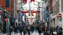 Shoppers pass along the pedestrianised Mary Street in Dublin. Photographer: Chris Ratcliffe/Bloomberg