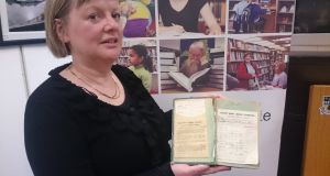 Senior executive librarian Nóirín O'Keeffe with the returned copy Ruby of a Thousand Dreams at the Kerry county library, at Moyderwell, Tralee. Photograph: Kerry County Library