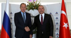 Russia's foreign minister Sergei Lavrov with his Turkish counterpart Mevlut Cavusoglu in Alanya, Turkey, on Thursday. Turkey is said to be brokering talks between Russia and Syrian rebels. Photograph: Reuters