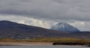 A snow-covered Mt Errigal as seen from Gola Island, off the west coast of Donegal. Photograph: Alan Betson