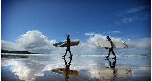 Surfers on Rossnowlagh beach in Co Donegal. Photograph: Bryan O'Brien