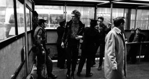 The Clash on a 1977 visit to Belfast, looking cool as they pass through a checkpoint. Photograph: Imperial War Museum