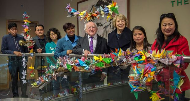 President Higgins arts installation by undocumented migrants. Image Credit: Irish Times