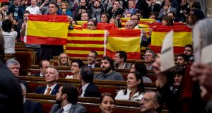 Representatives of Spain's governing Popular Party hold Spanish flags in the Catalan parliament in Barcelona last year, following a vote to begin the start of a secession process. Photograph: David Ramos/Getty Images