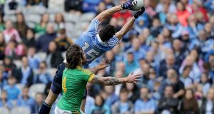 Dublin's Bernard Brogan catches a ball over the head of Meath's Mickey Burke. Photograph: Morgan Treacy