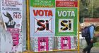 A man walks past referendum campaign posters  in Rome on Friday. Photograph: Vincenzo Pinto/AFP/Getty