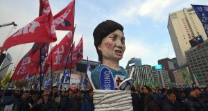 Protesters in Seoul carry an effigy of Park Geun-Hye during a rally demanding the resignation of the president. Photograph: Jung Yeon-Je/AFP/Getty Images