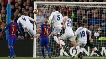 Real Madrid's Sergio Ramos scores a late equaliser at the Camp Nou. Photograph: Albert Gea/Reuters