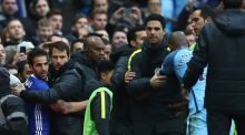 Staff and officials try to separate Fernandinho of Manchester City and Cesc Fabregas of Chelsea at Etihad Stadium. Photograph: Clive Brunskill/Getty Images