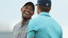 Tiger Woods enjoys a moment with Jordan Spieth on the practice range during round three of the Hero World Challenge at Albany, The Bahamas. Photograph: Christian Petersen/Getty Images