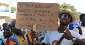 "Gambians celebrate no more ""backway"" at Westfield Junction in Serrekunda. Photograph: Lorraine Mallinder"