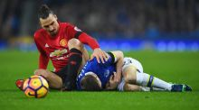 Zlatan Ibrahimovic of Manchester United tangles with Seamus Coleman during the match at Goodison Park. Photograph:  Laurence Griffiths/Getty Images