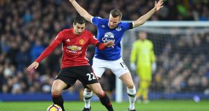 Manchester United's  Henrikh Mkhitaryan  shields the ball from  Everton's Tom Cleverley at Goodison Park on Sunday.  Photograph: Paul Ellis/AFP/Getty Images