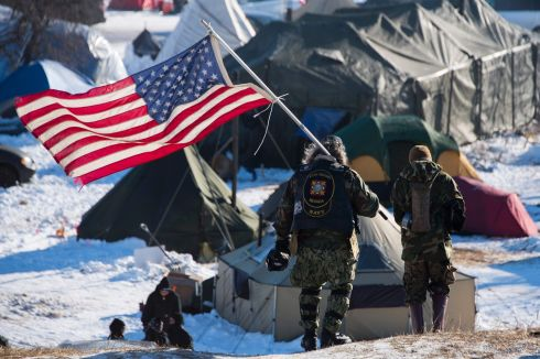 The Army Corps of Engineers said that it would not approve permits for construction of the Dakota Access Pipeline beneath a dammed section of the Missouri River.The decision is a victory for protesters at the Standing Rock reservation, who say the pipeline would threaten a water source and sacred Native American sites. Photograph: Jim Watson /AFP