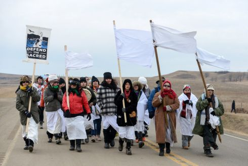 Women march to Backwater Bridge during a protest against plans to pass the Dakota Access pipeline near the Standing Rock Indian Reservation, near Cannon Ball, North Dakota, U.S. November 27th. Photograph: Stephanie Keith / Reuters