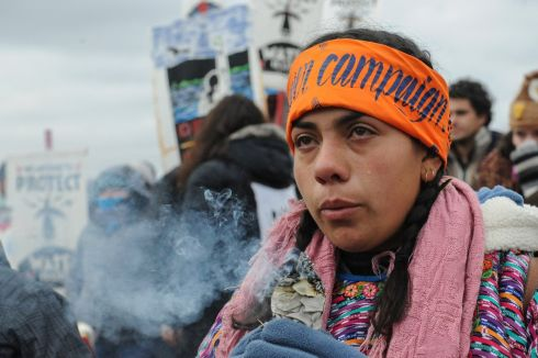 A protester cries while watching a demonstration on Turtle Island on Thanksgiving day during a protest against plans to pass the Dakota Access pipeline near the Standing Rock Indian Reservation, near Cannon Ball, North Dakota, U.S. November 24th. Photograph: Stephanie Keith / Reuters