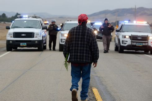 A protester blocks highway 1806 in Mandan during a protest against plans to pass the Dakota Access pipeline near the Standing Rock Indian Reservation, North Dakota, U.S. November 23rd.  Photograph: Stephanie Keith / Reuters