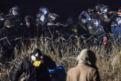 Police confront protesters with a rubber bullet gun during a protest against plans to pass the Dakota Access pipeline near the Standing Rock Indian Reservation, near Cannon Ball, North Dakota, U.S. November 20th.  Photograph: Stephanie Keith / Reuters