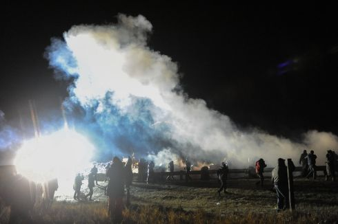 Police tear gas protesters during a protest against plans to pass the Dakota Access pipeline near the Standing Rock Indian Reservation, near Cannon Ball, North Dakota, U.S. November 20, 2016. Photograph: Stephanie Keith / Reuters