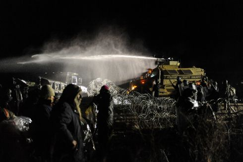 Police use a water cannon on protesters during a protest against plans to pass the Dakota Access pipeline near the Standing Rock Indian Reservation, near Cannon Ball, North Dakota, U.S. November 20th.  Photograph: Stephanie Keith / Reuters