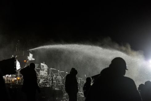 Police use a water cannon on protesters during a protest against plans to pass the Dakota Access pipeline near the Standing Rock Indian Reservation, near Cannon Ball, North Dakota, U.S. November 20, 2016. REUTERS/Stephanie Keith