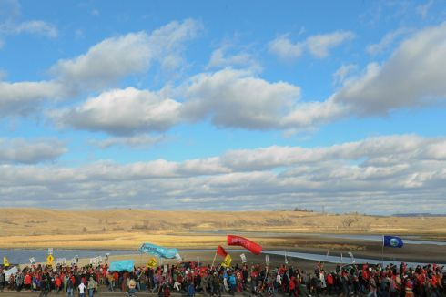 Protesters march along a road during a protest against plans to pass the Dakota Access pipeline near the Standing Rock Indian Reservation, near Cannon Ball, North Dakota, U.S. November 18th.  Photograph: Stephanie Keith / Reuters