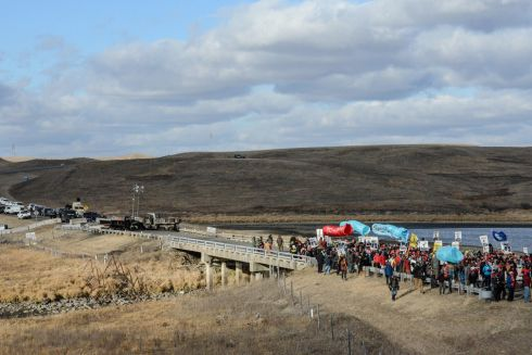 Protesters march from a bridge that separates an area where police are present and an area where demonstrators are present, during a protest against plans to pass the Dakota Access pipeline near the Standing Rock Indian Reservation, near Cannon Ball, North Dakota, U.S. November 18th. Photograph: Stephanie Keith / Reuters