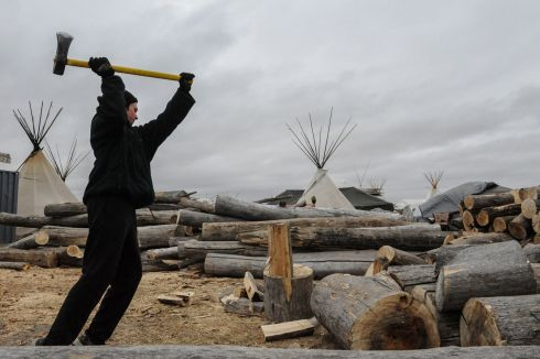 A man chops wood in an encampment during a protest against plans to pass the Dakota Access pipeline near the Standing Rock Indian Reservation, near Cannon Ball, North Dakota, U.S. November 17th.  Photograph: Stephanie Keith / Reuters