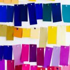 Not a Mummy Brown in sight: brightly coloured  swatches pinned to a wall. Photograph: Ohad Ben-Yoseph/Getty