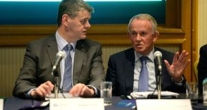 Chief executive Robert Pitt (left) and chairman Leslie Buckley at the Independent News and Media emergency general meeting in the O'Callaghan Alexander Hotel, Dublin, on Monday. Photograph: Cyril Byrne