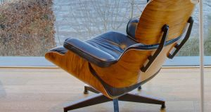 A lounge chair designed by Charles and Ray Eames. An original produced by the Italian company Vitra will cost thousands; a version is for sale through Voga at €895