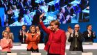 German chancellor Angela Merkel is applauded after addressing delegates during her Christian Democratic Union (CDU) party's congress in Essen, western Germany, on Tuesday. Photograph:  Tobias Schwarz/AFP/Getty Images