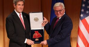 US secretary of state John Kerry   receives the Federal Cross of Merit  award from German foreign minister Frank-Walter Steinmeier  in Berlin, Germany.  Photograph: Adam Berry/Getty