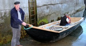 Inishbofin resident John Concannon with a currach he made. Photograph: Marie Coyne